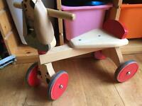 Ride on wooden dog toy
