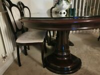 Used Italian Dining table with 6 chairs and with half inch thick toughned glass top