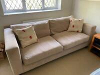 Large comfy fabric sofa.