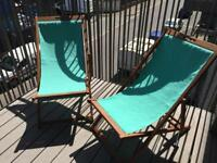 2 teal deck chairs