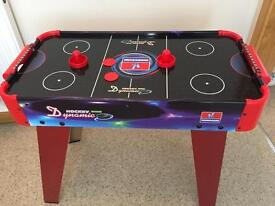 Kids indoor air hockey table game.