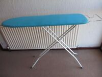 Ironing Board, Metal, with Iron rest Blue cover.