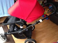Bugaboo Buffalo Dec 2015 - True black frame and extendable red hood