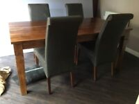 Solid wood dining table and 4 chairs in distressed leather