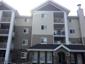 CRAZY VALUE! 1 Bed + Den newer Condo in Sylvan Lake ONLY $895