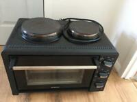 Oven with hobs