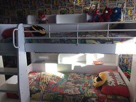 Bunk bed with storage shelfs