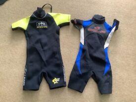 2 children's wetsuits