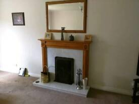 Pine and marble fire place