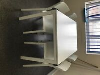 White ikea dining table + 4 Chairs. Table 125cmx75cm (and 75cm High)