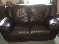 2 seater brown leather reclining sofa.