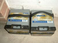 TWO VARTA BATTERIES WITH CHARGER. SUITABLE FOR CARAVAN OR BOAT .