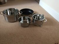 Brand new set of 4 pans (boxed)