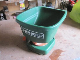 Rotating hand seed spreader