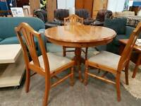 Pine round extendable table with three chairs