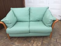 Mint green 2 seater leather sofa in excellent condition originally bought from Barker & Stonehouse