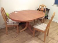A cute dinning table for sale, with chairs