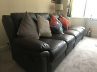 Beautiful soft leather reclining sofa in immaculate condition.