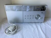 SHARP CD player and fm tuner. Excellent sound quality and chic design. Front loading CD player.