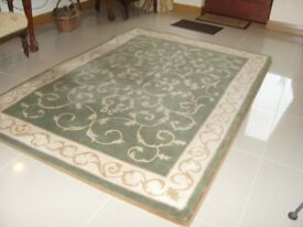 Rug heavy wool rug 7 foot 6 inches X 5 foot 3 inches good condition