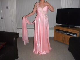 Must be seen to appreciate how lovely this pink prom dress really is.