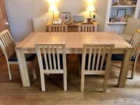 Light oak extending dining table with chairs plus sideboard and cabinet. All solid oak.