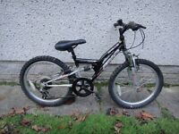 Apollo FS20 bike, 20 inch wheels, 6 gears, full suspension, black, suit age 5 to 7 years