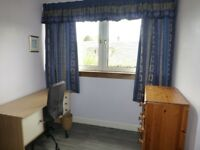 Large double bedroom with study area and tv area and plenty storage in house with a secluded garden