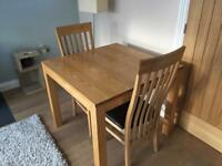 Excellent fenwicks solid wood table and two chairs