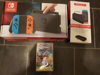 Brand new sealed Nintendo Switch with Mario Kart and carry case