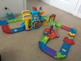 VTech Baby Toot Toot Drivers Garage in good condition plus 5 vehicles
