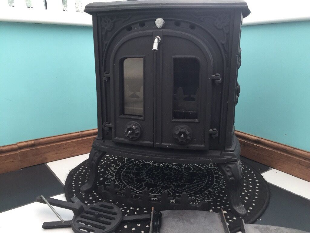 log/coal fire double door stove brand new cast iron