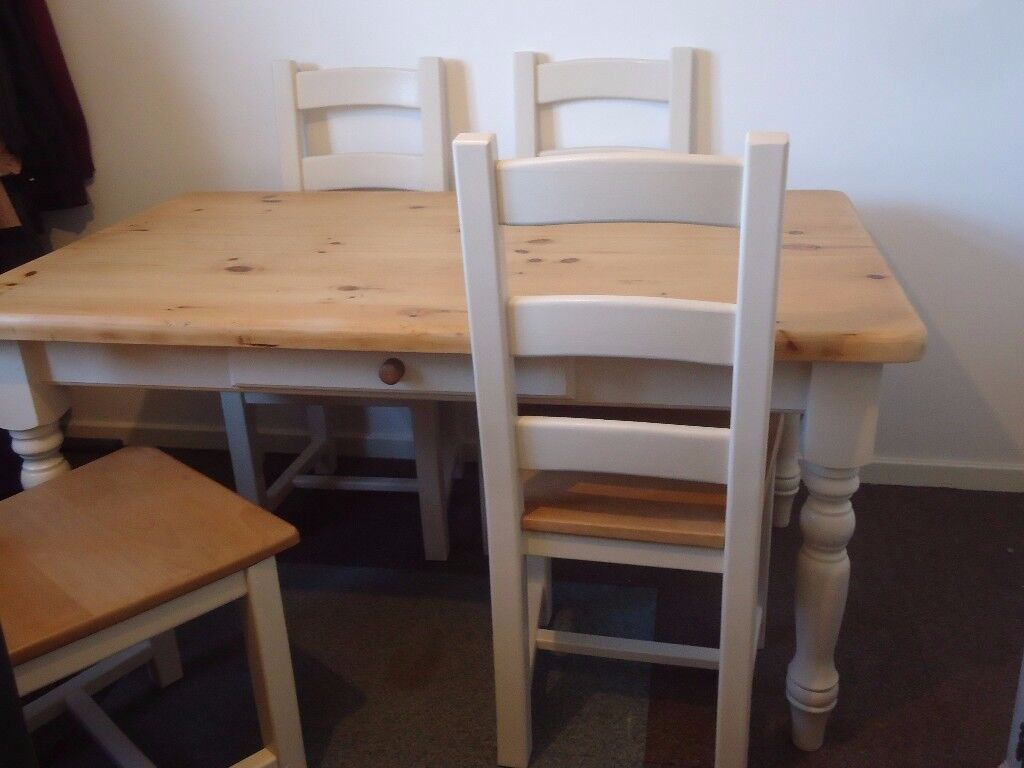 Rustic Wooden Farmhouse Table and Four Ladder Back Chairs