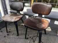 Pair of Eames LCW style chairs in cowhide