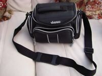 Camera/Camcorder Case with strap which is adjustable. Lots of zip pockets with space