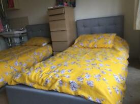 Two identical single beds only one week old