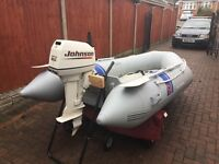 Sea bo Silver marine inflatable with Johnson outboard for sale