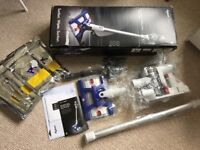 AS NEW/ UNUSED Dyson DC56 Hard Floor/Wipe Handheld Vacuum
