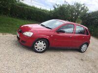 Red Vauxhall Corsa