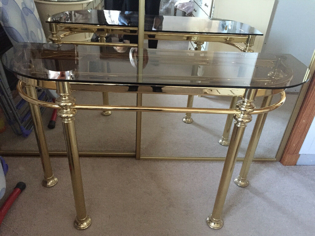 Glass and brass console table..