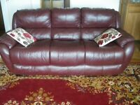 BROWN LEATHER THREE SEATER SUITE AND TWO MATCHING ARMCHAIRS