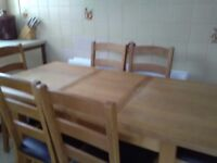 Oak extending table and six chairs. Good condition. Antrim area