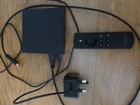 Amazon Fire TV Box with remote control and power plug