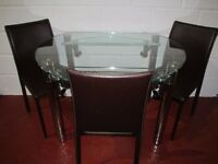 FOLDABLE GLASS DINING TABLE MINT CONDITION FREE DELIVERY IN LIVERPOOL