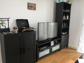 TV stands with shelving unit, black color, the length is 2,35mt and max height is 1,85mt.
