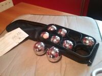 Full set of boules heavy metal set with zipped cloth carry case never been used.