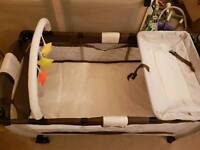 Foldable travel cot with nappy changer