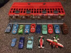 """""Disney cars storage case/launch track with 14 cars and a plane """""