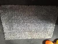 Grey shag pile rug