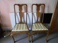 2 wooden Queen Anne style dining chairs.